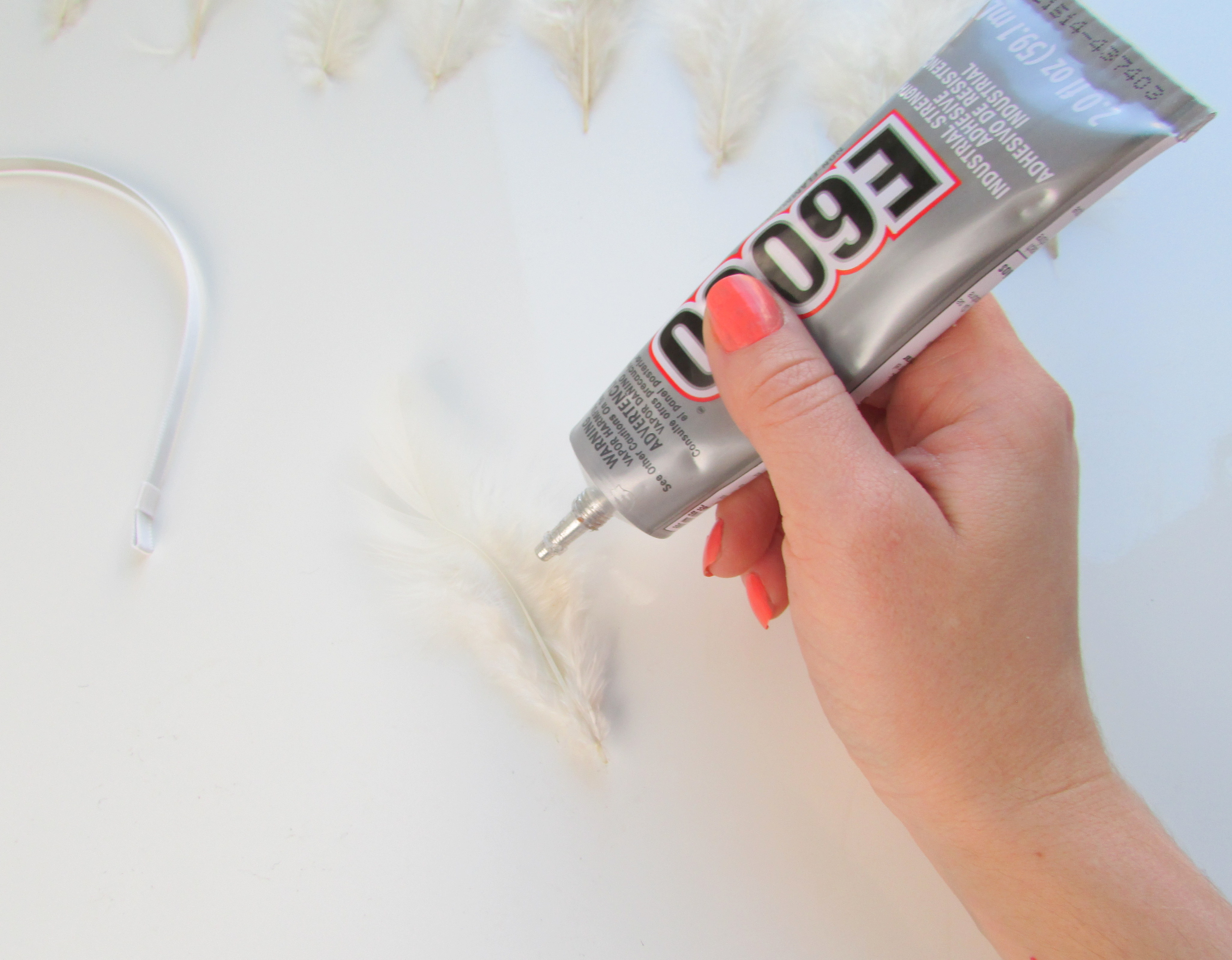 Glueing the feather with adhesive