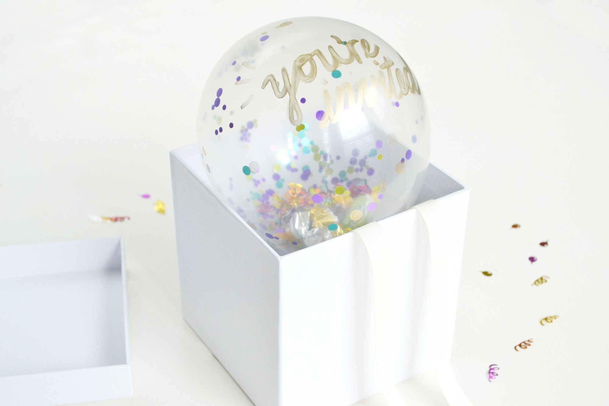 DIY Confetti Balloon Invites to Pop a Party