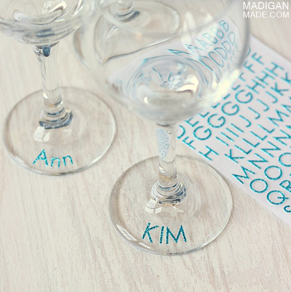 Stickers are another great wine glass marker idea madigan made used glittery blue letter stickers to spell out guests names but you could really use any