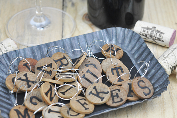 stamped wooden wine charms