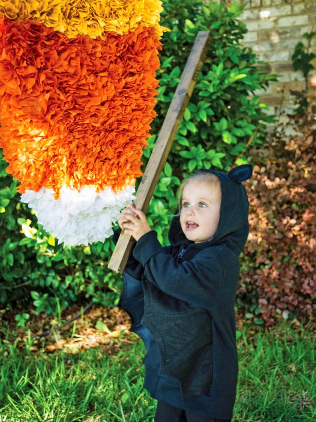 original_Sam-Henderson-Halloween-handmade-candy-corn-pinata-beauty-with-kid.jpg.rend.hgtvcom.616.822