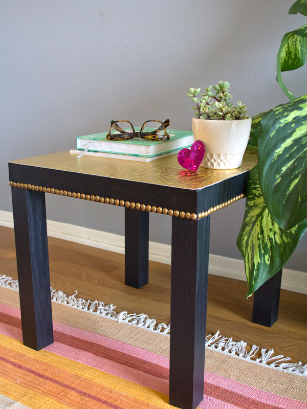 studded gold lack table