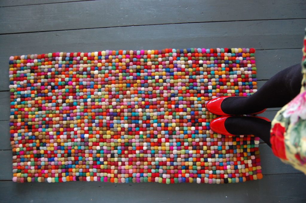 colorful pom pom rug