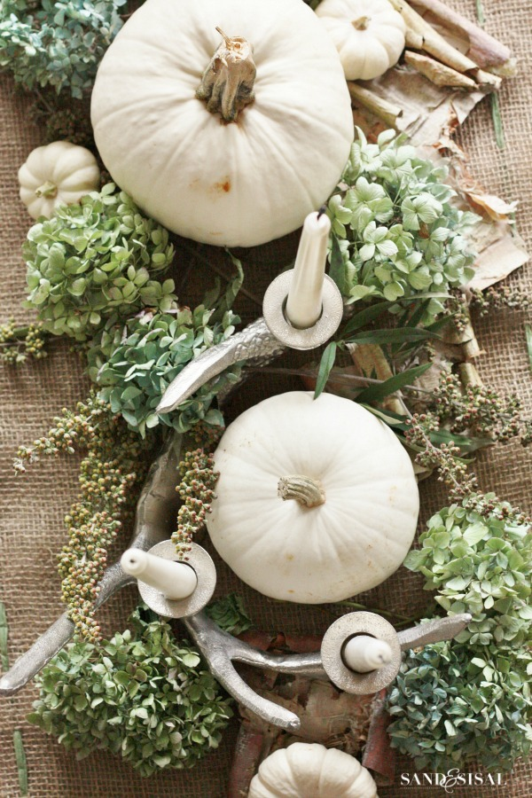 white pumpkins green hydrangeas