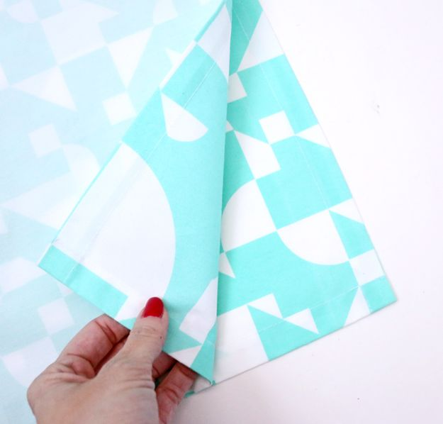Create A Pillowcase Out of Napkins – lay one
