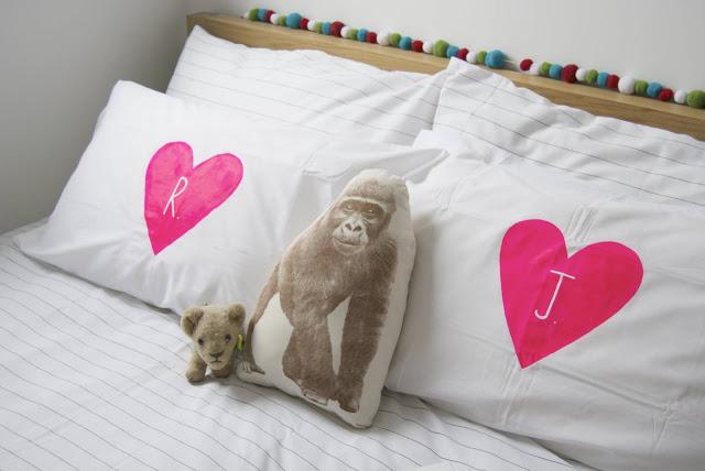 12 pink neon heart pillows