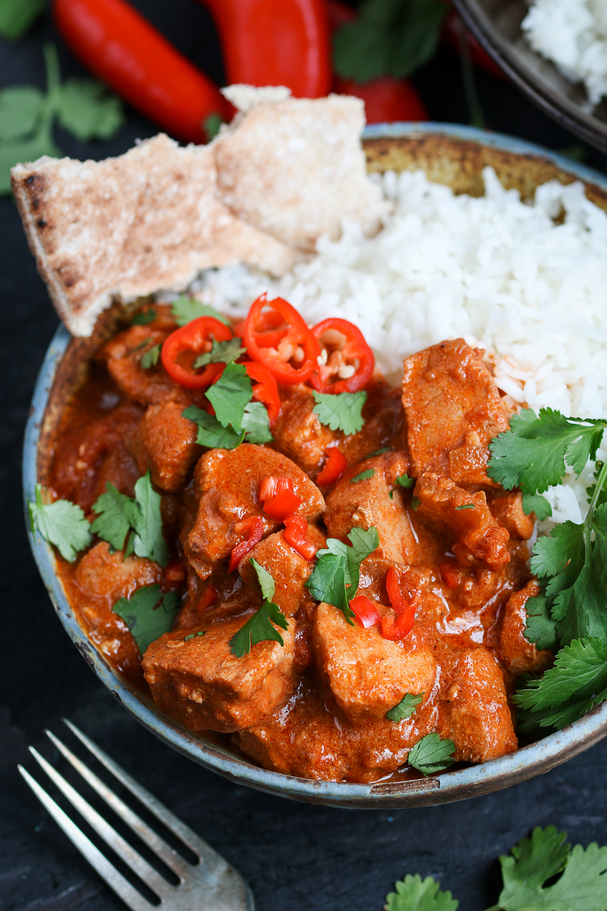 An easy from-scratch crockpot chicken curry with a kick of chili spice.