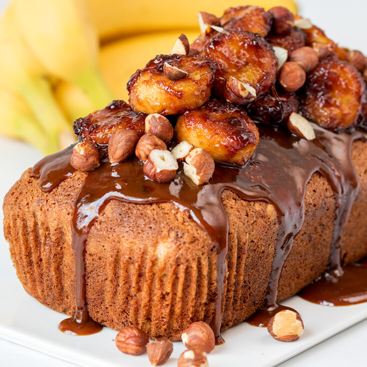 A beautifully moist banana bread topped with sticky-sweet bananas and crunchy hazelnuts.