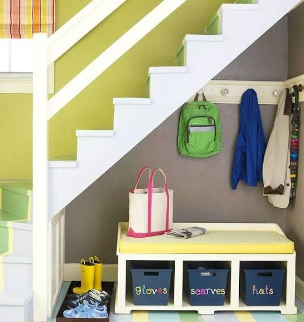Colorful walls and space understairs for storage and clothes