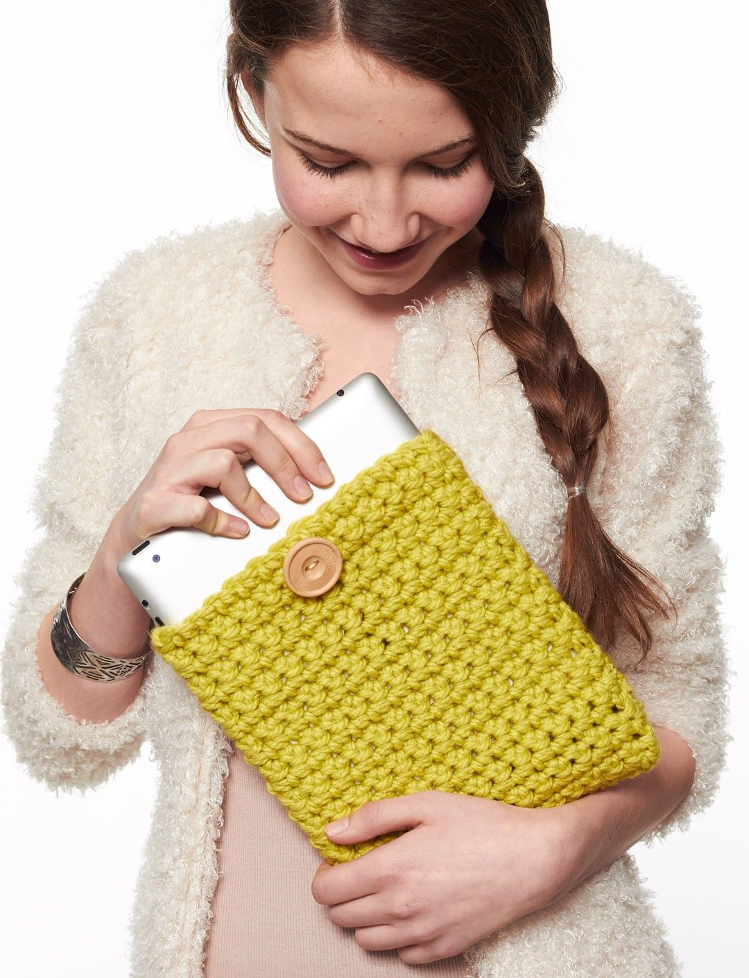 Crocheted yellow tablet cover