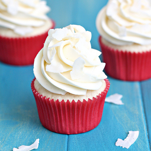 White coconut cupcake with coconut swiss meringue buttercream