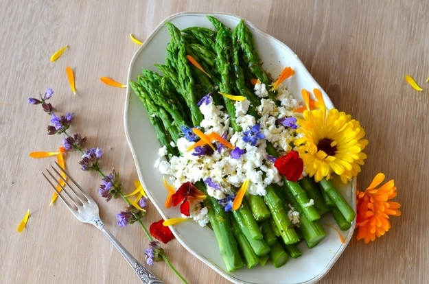 Asparagus, goat cheese, and flowers with orange vinaigrette