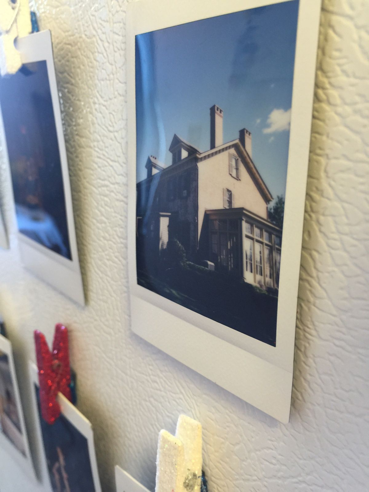Display polaroid photographs hang