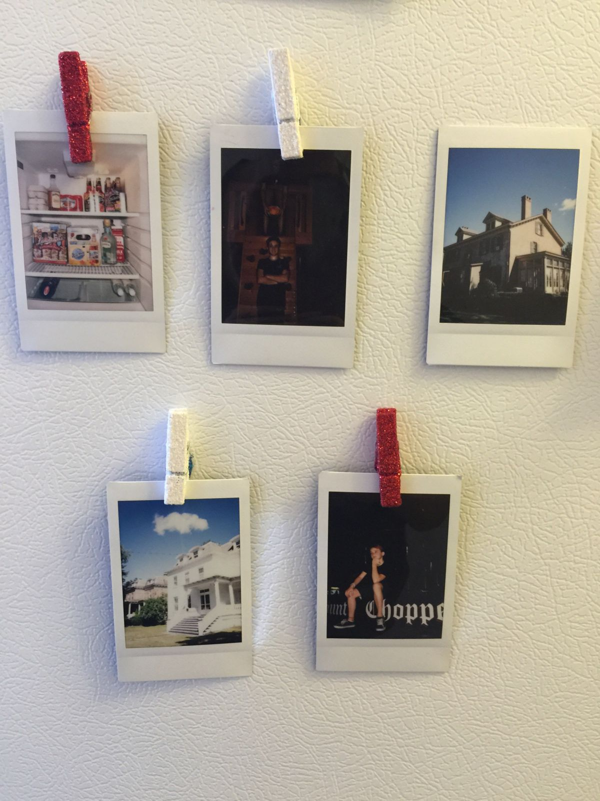 Display polaroid photographs on wall