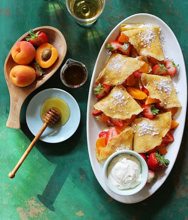Hazelnut crepes with honey whipped cream and fruit