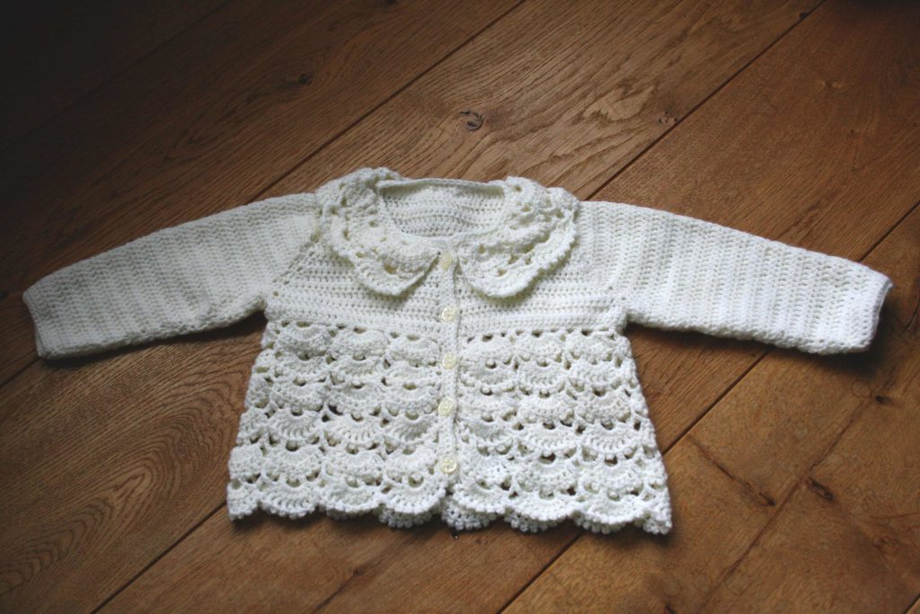 Collared lace baby cardigan