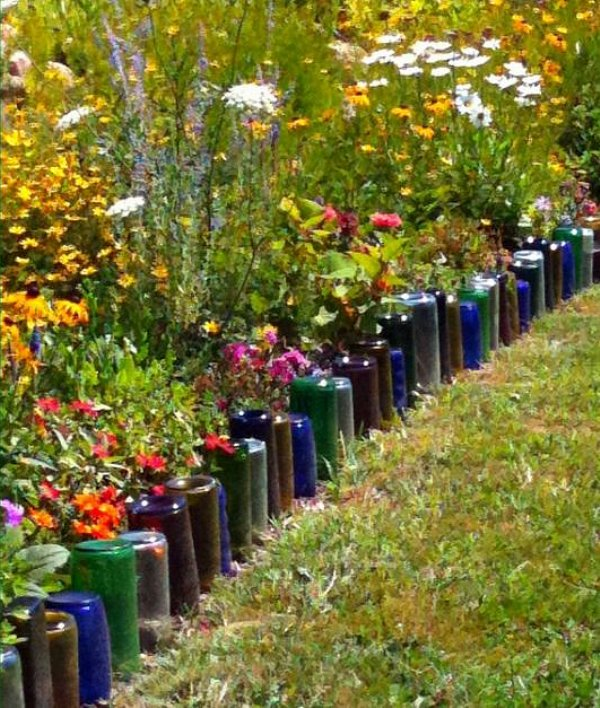 Recycle old wine bottles to create a garden edge