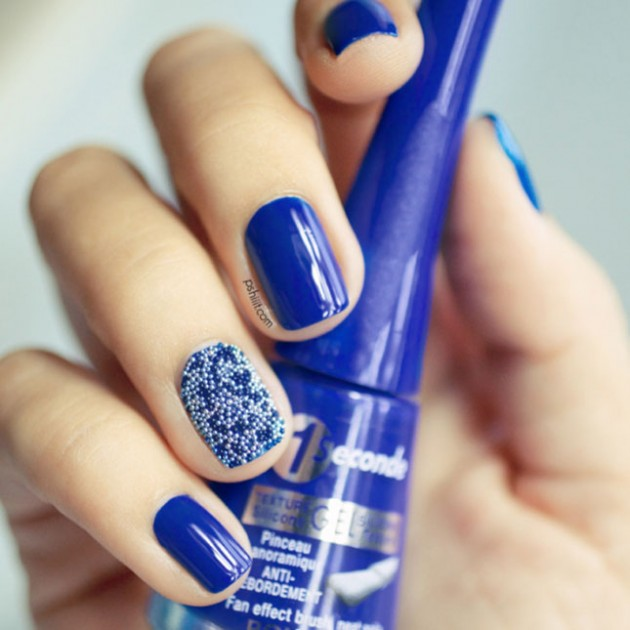Blue with a caviar accent nail