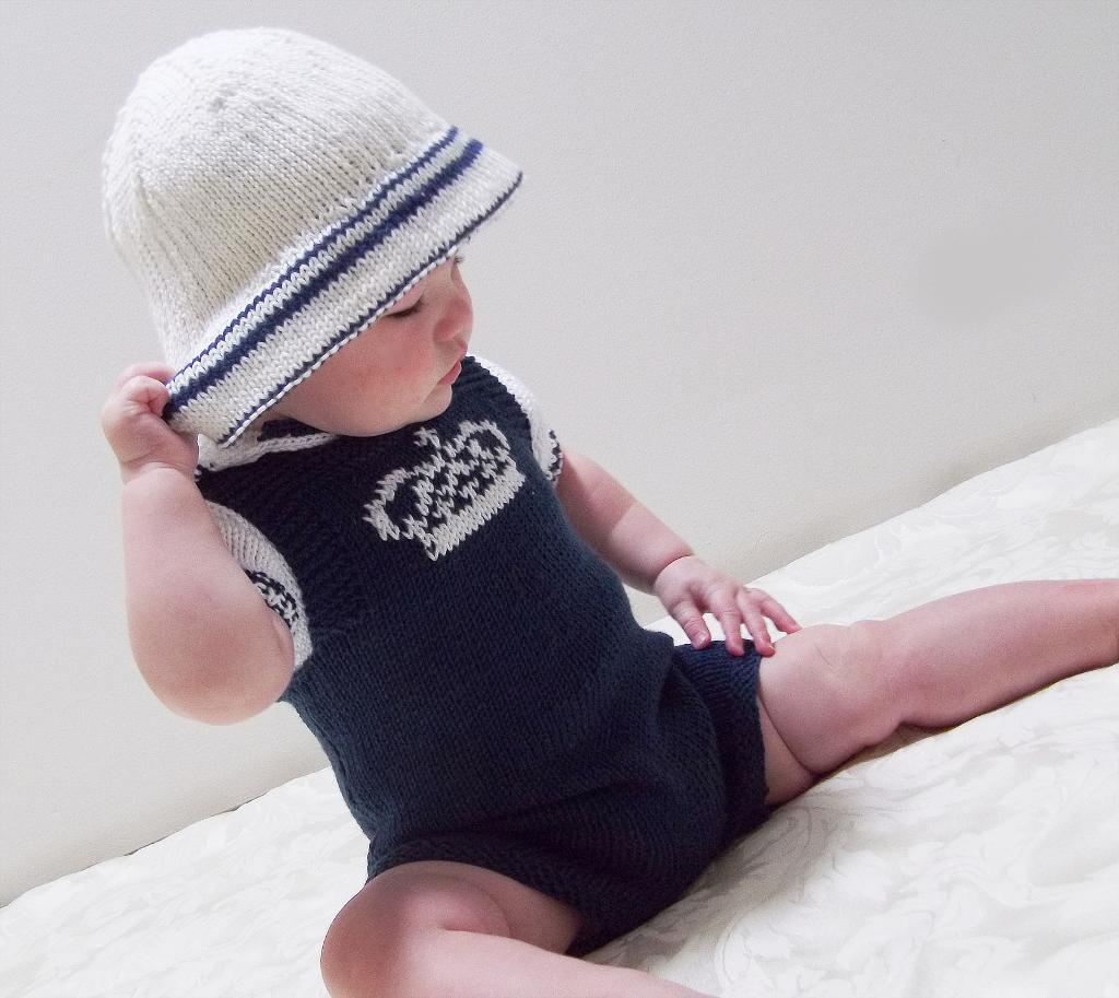 Dungarees, polo shirt, and sun hat set by oge knitwear designs