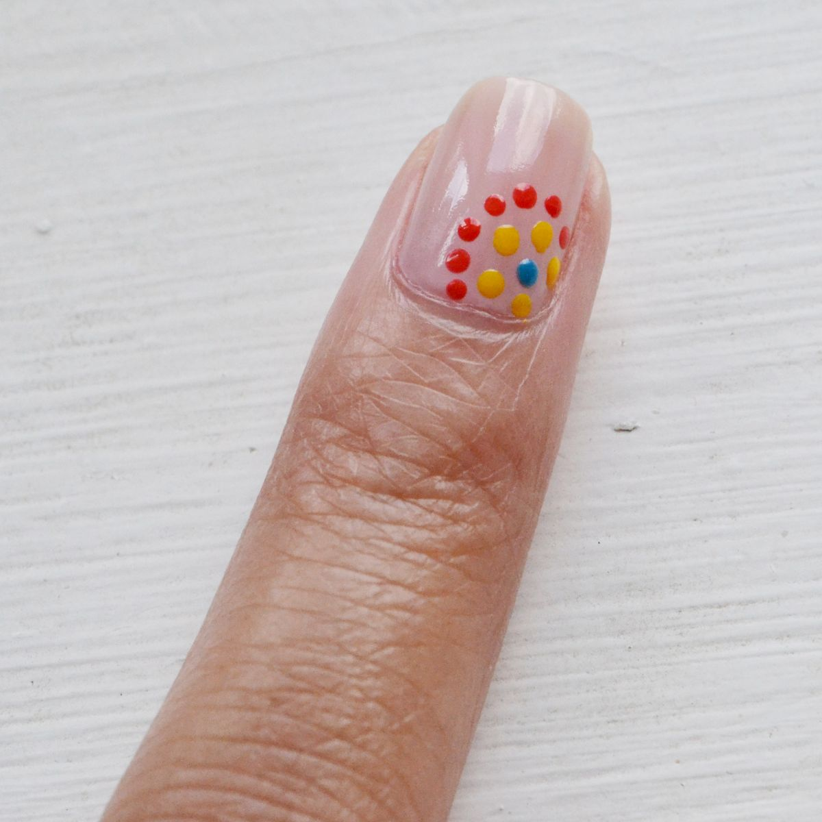 Festive dotted nails colorful