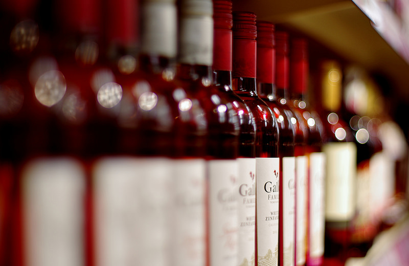Many red bottles benefits of wine