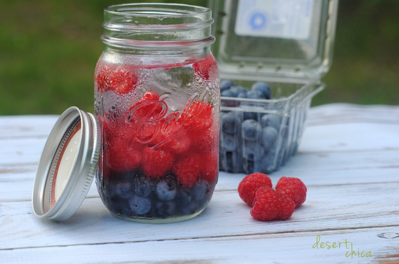 Blueberry and raspberry infused water in a mason jar