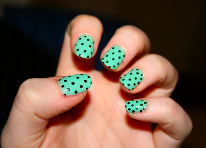 Mint nails with black polka dots