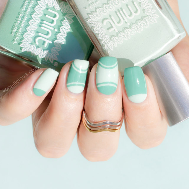 Outlined half moon mint manicure