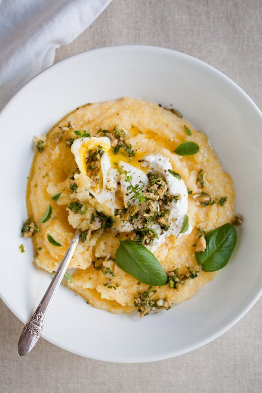 Poached egg over polenta with basil herb pesto