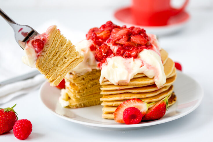 Fluffy pancakes with a simple cheesecake and strawberry compote topping!