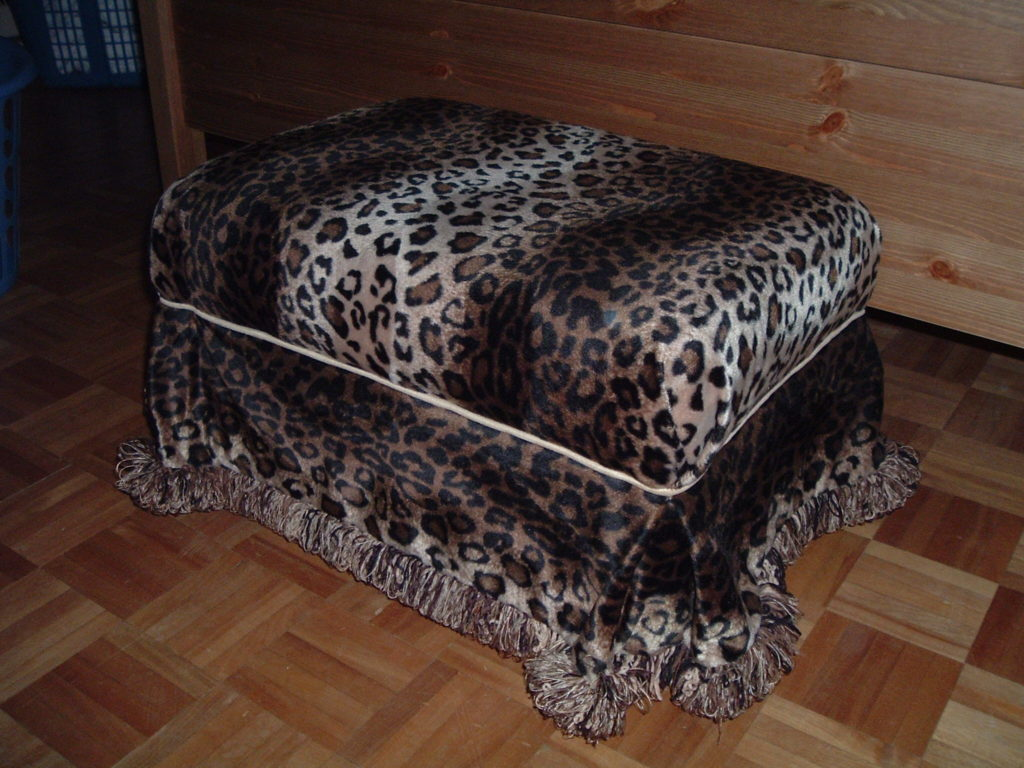 Leopard print covered ottoman