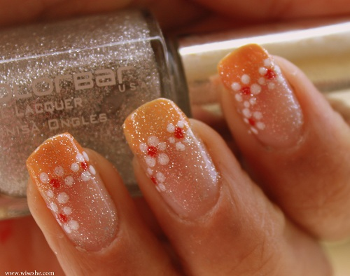 Orange french manicure with flower art and glitter