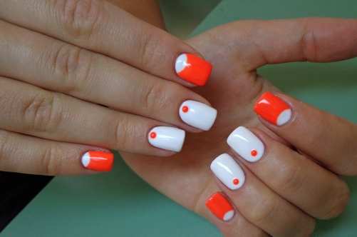 Orange and white dots and half moons