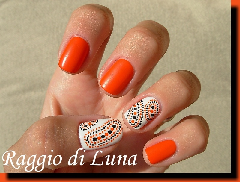 Orange, white, and black abstract dots