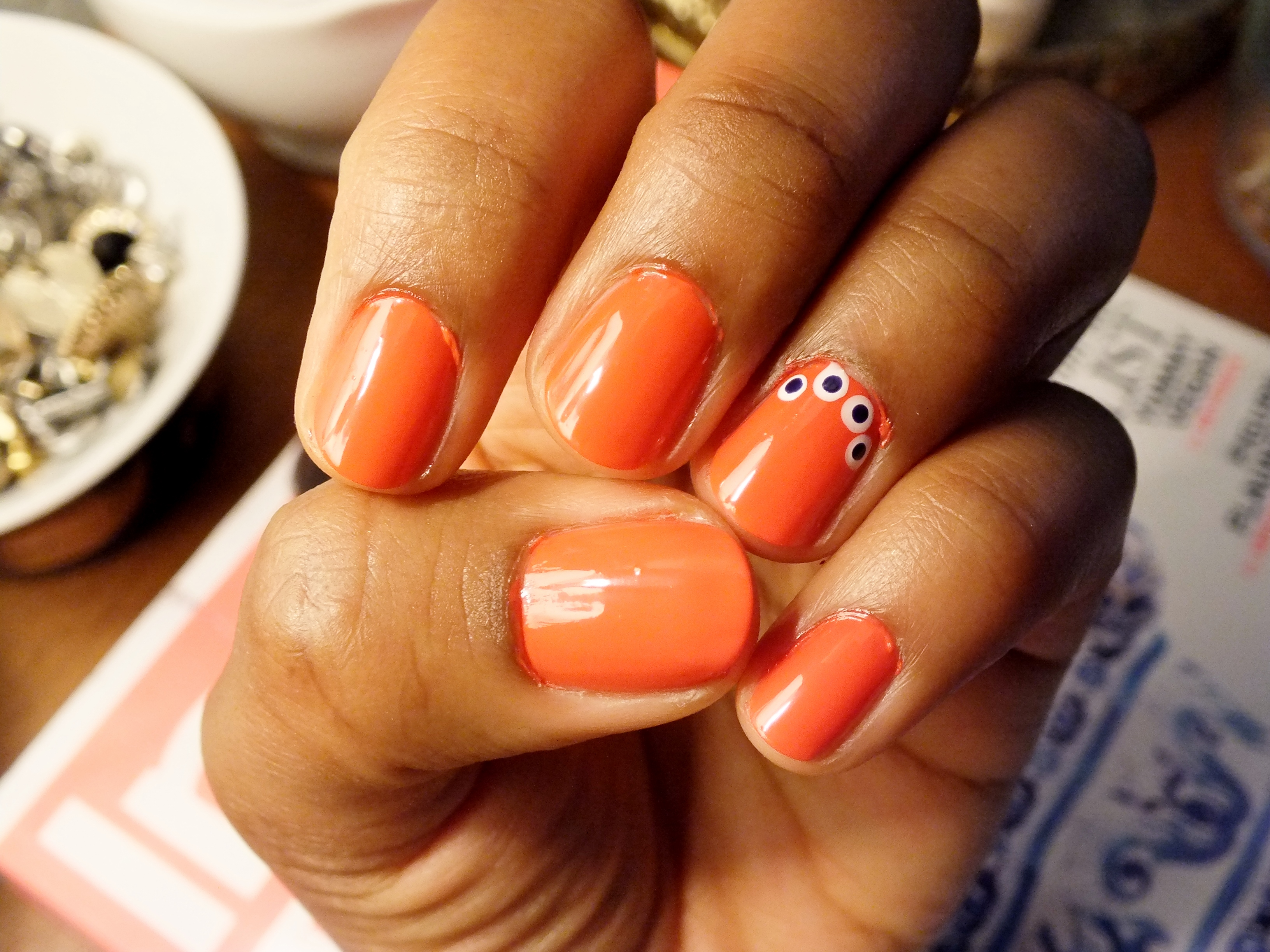Orange with white and blue dots