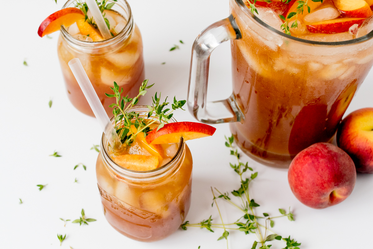 Sweet and refreshing peach and thyme iced tea - the perfect drink to cool you down on a hot day!