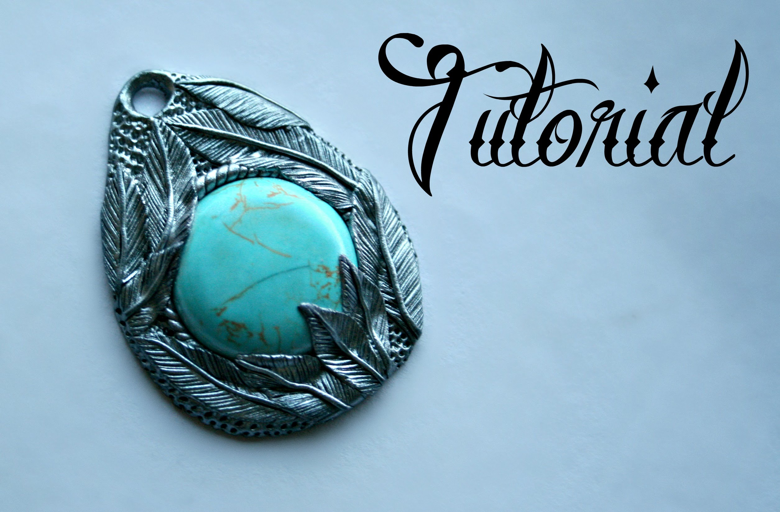 Silver and turquoise polymer clay feather pendant
