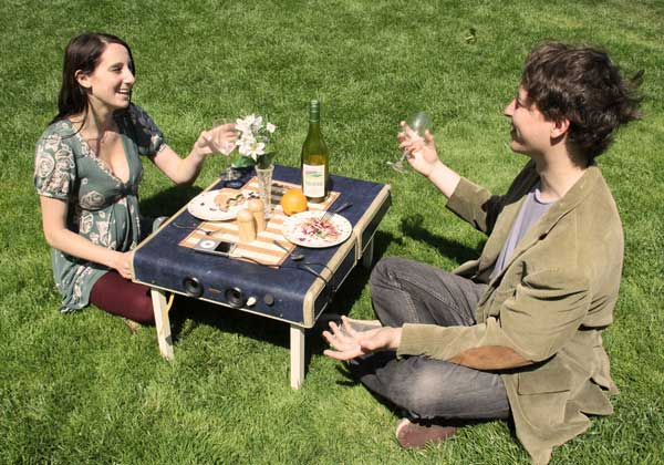 Suitcase picnic table with built in speakers