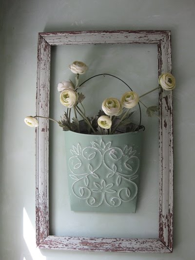Worn frame and tin flower hanger