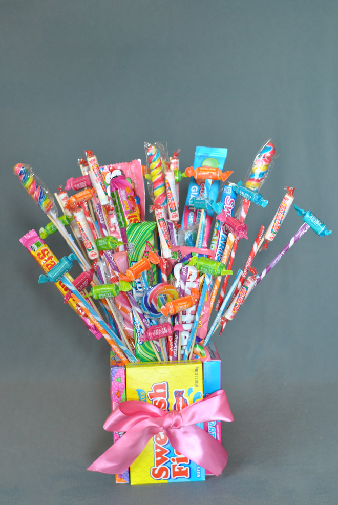 Candy box and candy sticks bouquet
