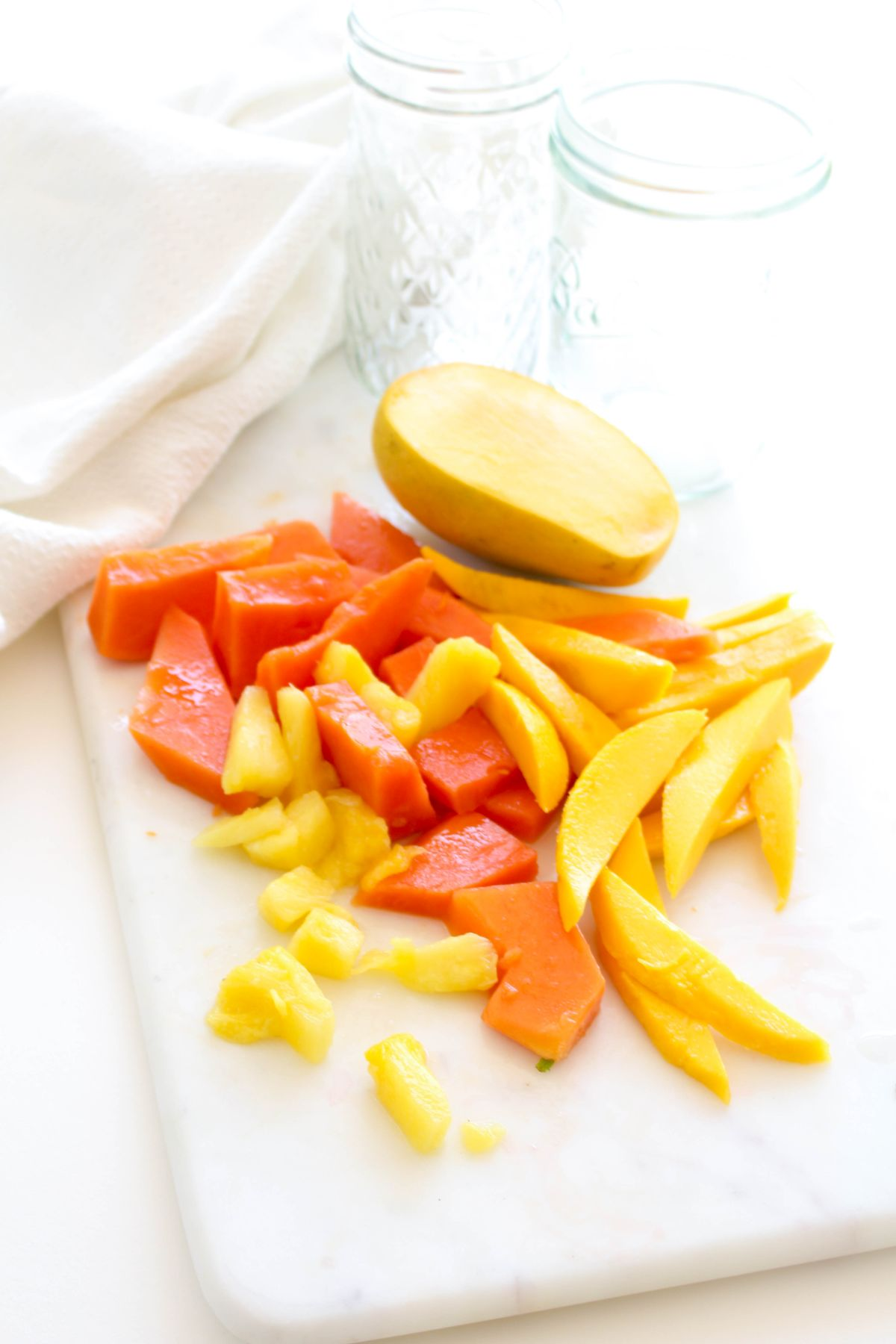Chop the papaya mango and pineapple