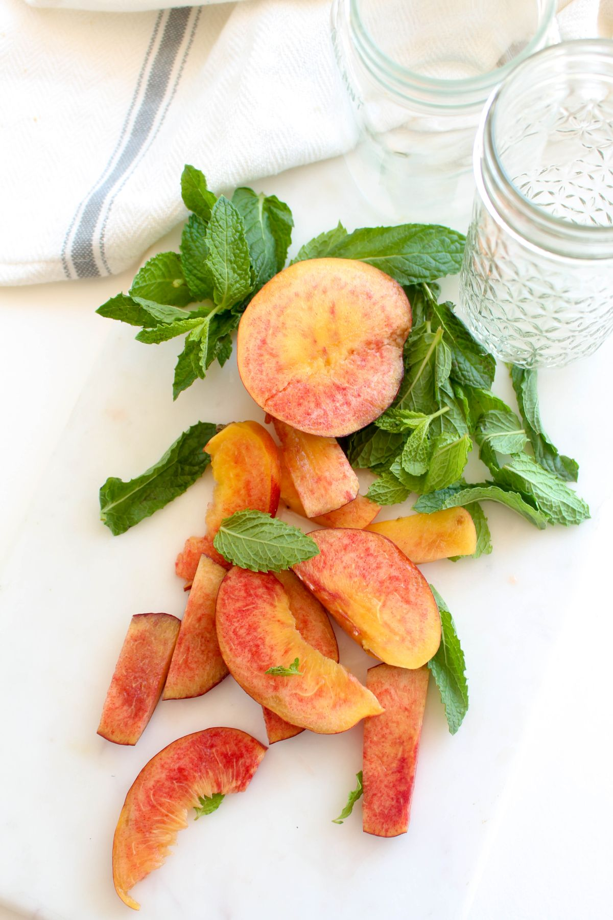 Chop the peaches and pull the mint leaf