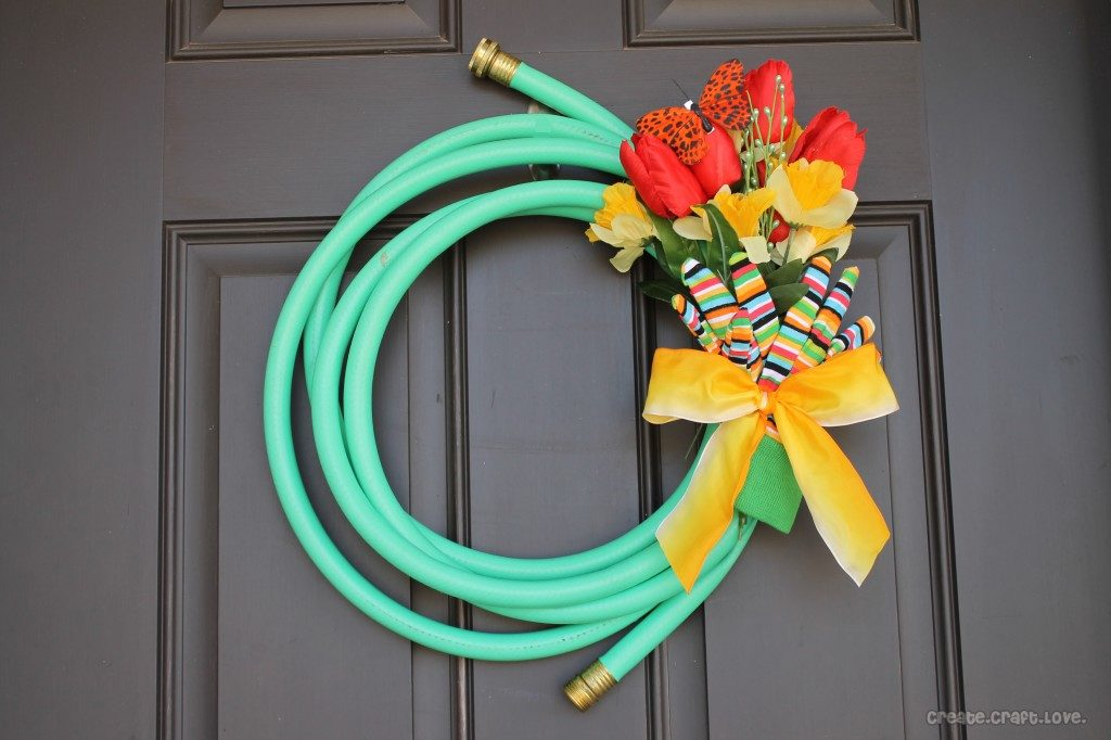 Garden hose and flower door wreath