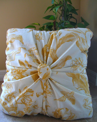Gathered pillow with a button centre