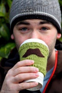 Knitted mustache coffee sleeve