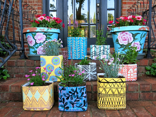 Painted kitty litter planters