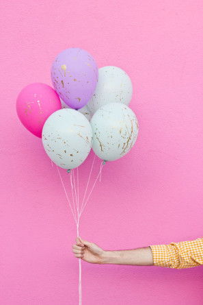 Pastel and gold paint splattered balloons