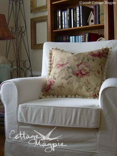 Sewn throw pillow cover with a pom pom edge