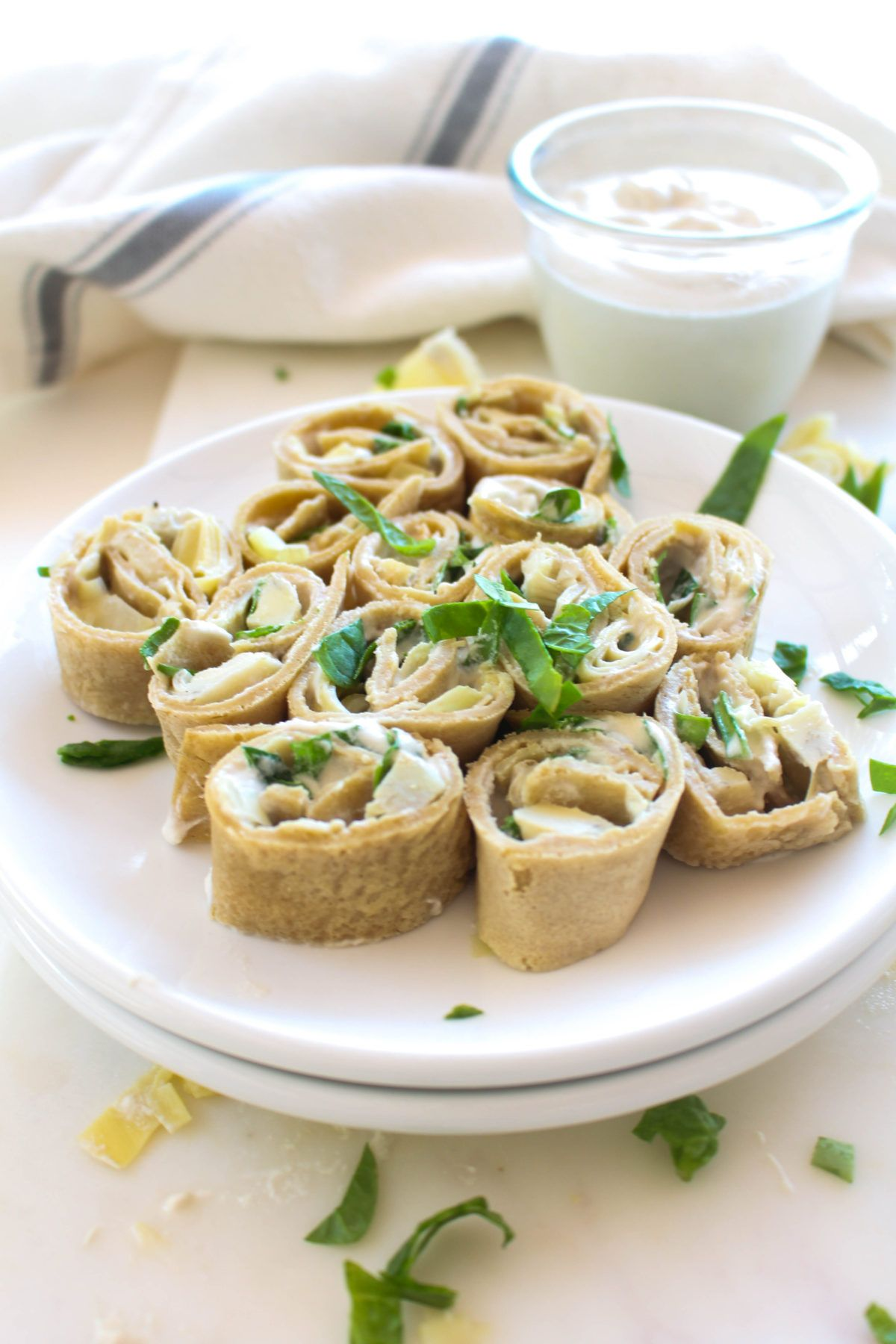 Spinach artichoke pinwheels roll and serve