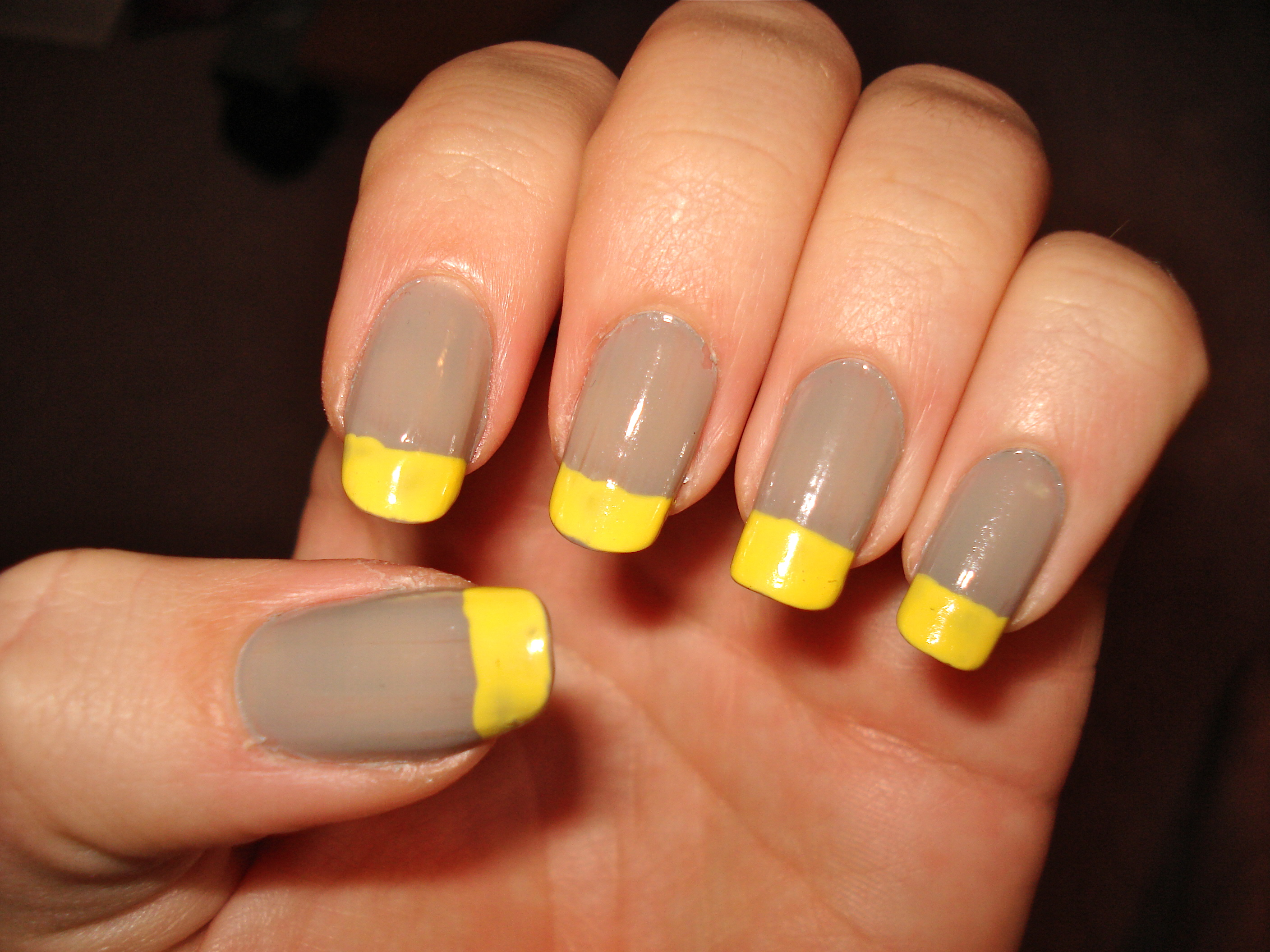 Taupe manicure with bright yellow tips